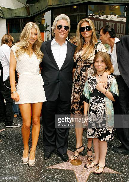Producer John Peters poses wife Mindy and his daughters Caleigh and Kendyl at the ceremony honoring him with a star on the Hollywood Walk of Fame May...