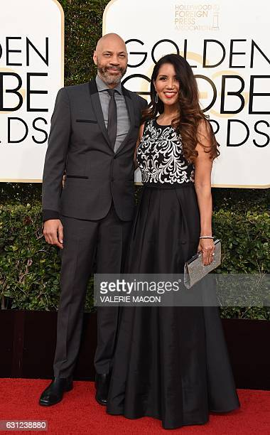 Producer John Ridley and Gayle Ridley arrive at the 74th annual Golden Globe Awards January 8 at the Beverly Hilton Hotel in Beverly Hills California...