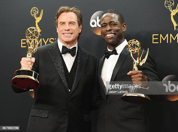 Producer John Travolta and actor Sterling K. Brown pose in the press room at the 68th annual Primetime Emmy Awards at Microsoft Theater on September...