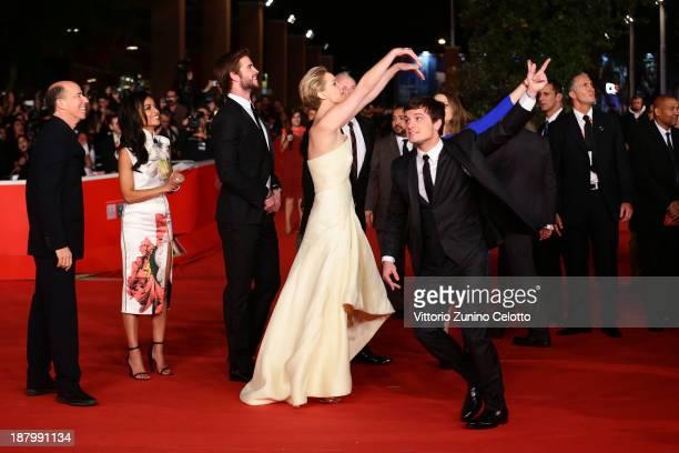 Producer Jon Kilik Meta Golding actors Liam Hemsworth Jennifer Lawrence and actor Josh Hutcherson attend the 'The Hunger Games Catching Fire'...