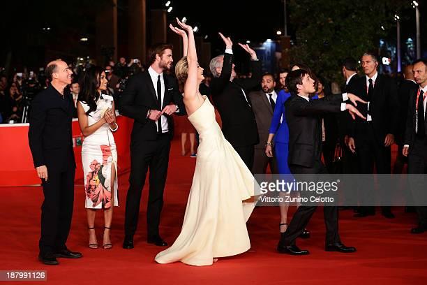 Producer Jon Kilik Meta Golding actors Liam Hemsworth Jennifer Lawrence director Francis Lawrence and actor Josh Hutcherson attend the 'The Hunger...