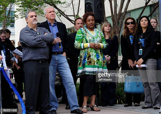 Producer Jon Landau director James Cameron and actress CCH Pounder plant first tree in North America symbolizing the one million tree initiative on...