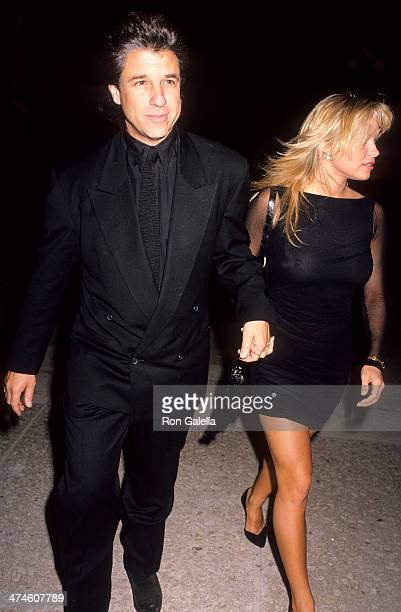 Producer Jon Peters and actress Pamela Anderson attend the Glory Century City Premiere on December 11 1989 at the Cineplex Odeon Century Plaza...