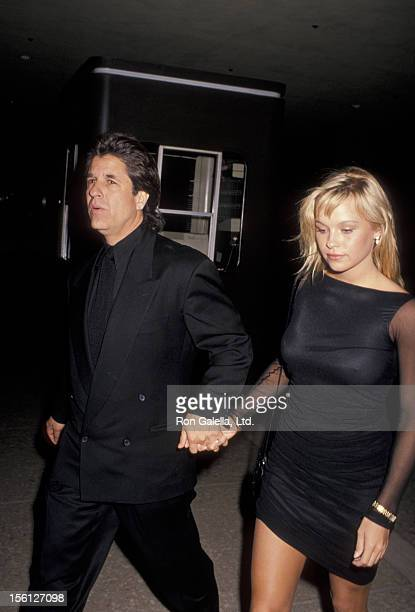 Producer Jon Peters and model Pamela Anderson attend the premiere of 'Glory' on December 11 1989 at the Cineplex Odeon Cinema in Century City...