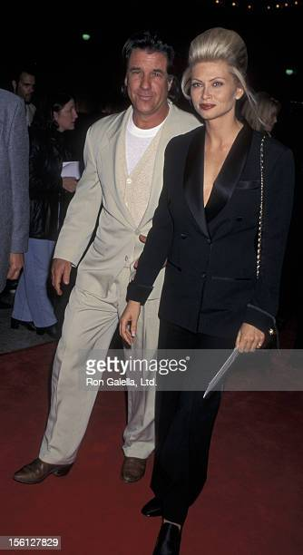 Producer Jon Peters and wife Mindy Williamson attend the premiere of 'Money Train' on November 12 1995 at the Cineplex Odeon Cinema in Century City...