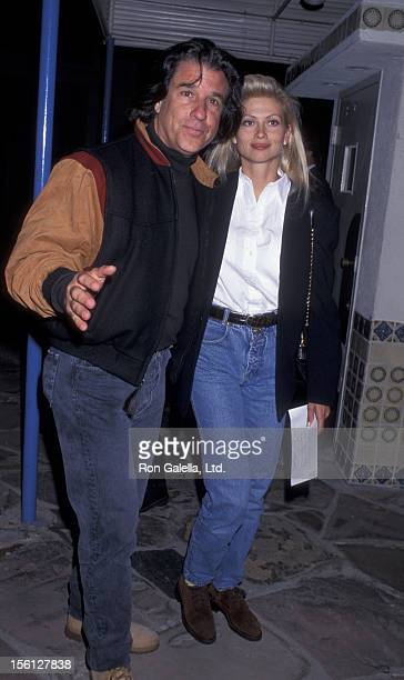 Producer Jon Peters and wife Mindy Williamson attend the world premiere of 'Twister' on May 8 1996 at Mann Village Theater in Westwood California