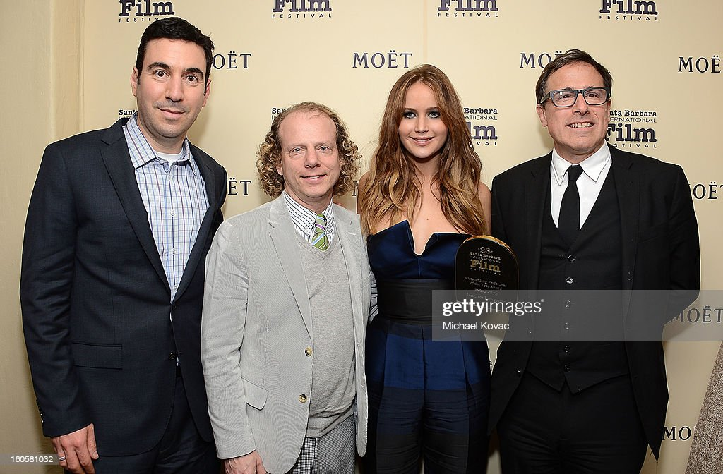 Producer Jonathan Gordon, producer Bruce Cohen, actress Jennifer Lawrence and director David O. Russell visit The Moet & Chandon Lounge at The Santa Barbara International Film Festival on February 2, 2013 in Santa Barbara, California.