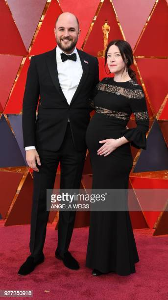 US producer Jordan Horowitz and his wife Julia Hart arrive for the 90th Annual Academy Awards on March 4 in Hollywood California / AFP PHOTO / ANGELA...