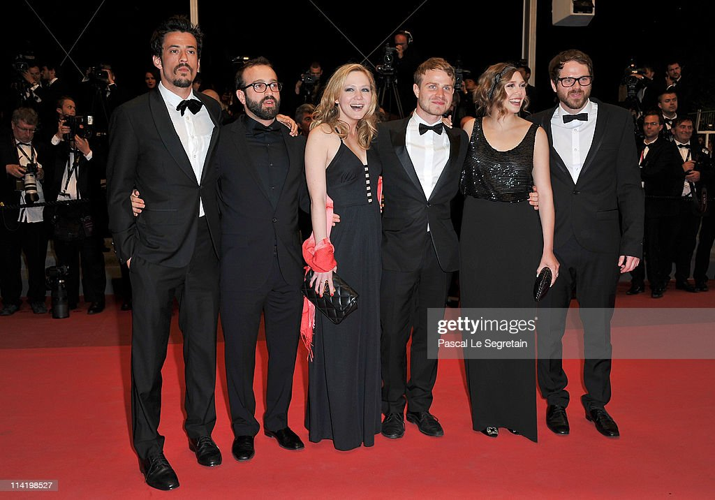 Producer Josh Mond, producer Antonio Campos, Louisa Krause, Brady Corbet, Elizabeth Olsen and director Sean Durkin attend the 'Martha Marcy May Marlene' premiere during the 64th Cannes Film Festival at the Palais des Festivals on May 15, 2011 in Cannes, France.