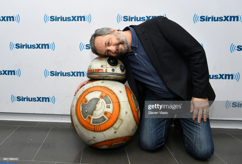Producer Judd Apatow poses with Star Wars character, Astromech Droid BB-8 at SiriusXM Studios on December 13, 2017 in New York City.