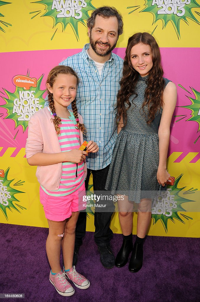 Producer Judd Apatow (C) with daughters Iris Apatow (L) and Maude Apatow arrives at Nickelodeon's 26th Annual Kids' Choice Awards at USC Galen Center on March 23, 2013 in Los Angeles, California.