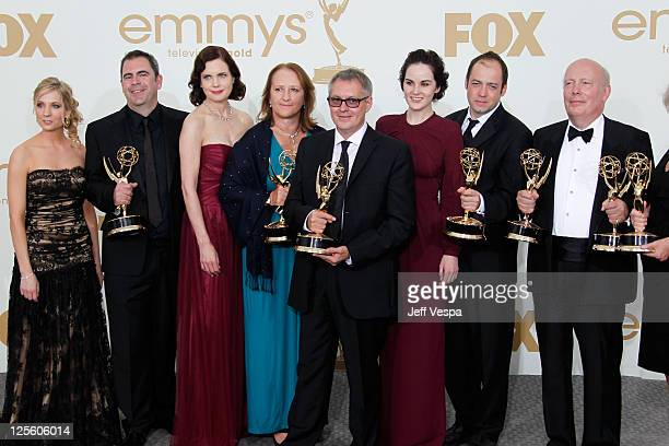 "Producer Julian Fellowes and fellow cast and crew of ""Downton Abbey"" pose in press room during the 63rd Primetime Emmy Awards at the Nokia Theatre..."