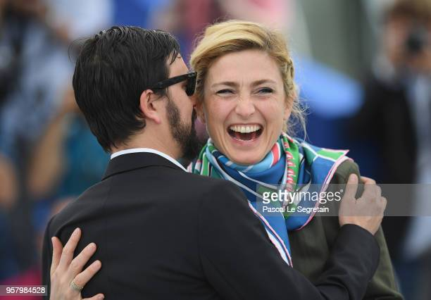 Producer Julie Gayet is kissed by director Alejandro Fadel attends the photocall for 'Murder Me Monster ' during the 71st annual Cannes Film Festival...