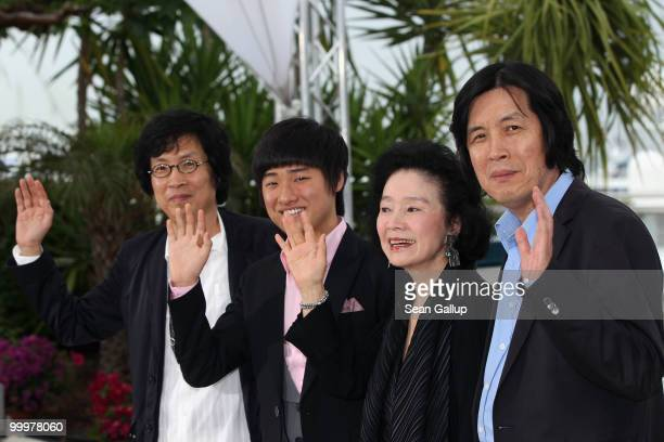 Producer Jundong Lee actor David Lee actress Yun Jung Hee and director Changdong Lee attend the 'Poetry' Photocall at the Palais des Festivals during...