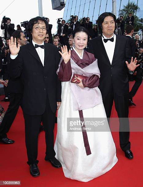 Producer Jundong Lee actress Jeonghee Yoon and ChangDong Lee of the film 'Poetry' attend the Palme d'Or Award Closing Ceremony held at the Palais des...