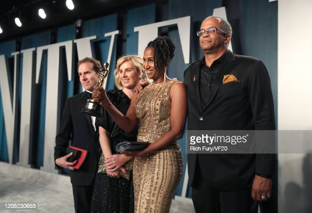 """Producer Karen Rupert Toliver poses with the Oscar for Best Animated Short Film for """"Hair Love"""" as she attends the 2020 Vanity Fair Oscar Party..."""