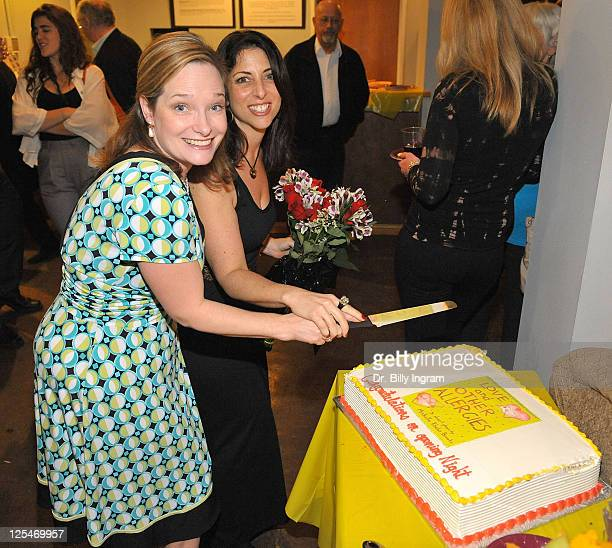 Producer Katherine Phillips Moser and writer Michelle Kholos Brooks cut the cake at the after party for the Opening Night Premiere of the Play Love...