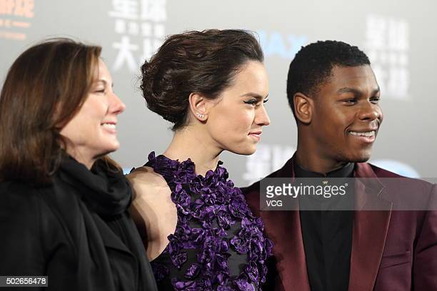 Producer Kathleen Kennedy actress Daisy Ridley and actor John Boyega attend Star Wars The Force Awakens premiere at Shanghai Grand Theatre on...