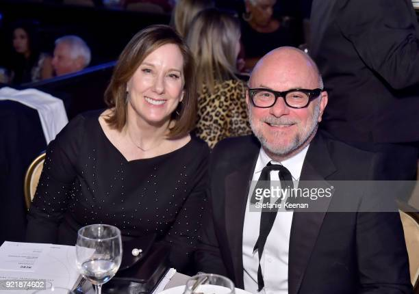 Producer Kathleen Kennedy and Eric Buterbaugh attend the Costume Designers Guild Awards at The Beverly Hilton Hotel on February 20 2018 in Beverly...