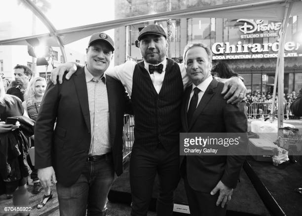 """Producer Kevin Feige actor Dave Bautista and executive producer Louis D'Esposito at The World Premiere of Marvel Studios' """"Guardians of the Galaxy..."""