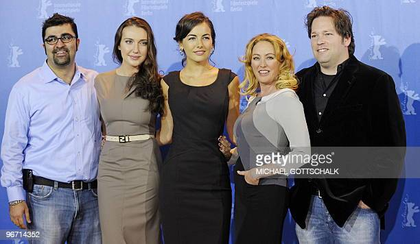 US producer Kia Jam actresses Anna Anissimova Camilla Belle and Virginia Madsen and director Trent Cooper pose for photographers at the press...