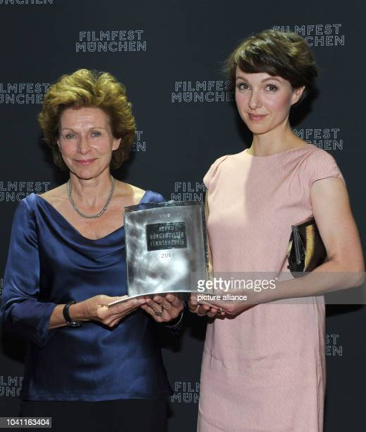 Producer Kirsten Hager and leading actress Julia Koschitz pose with the Bernd Burgemeister Television Award for the drama 'Pass gut auf ihn auf'...