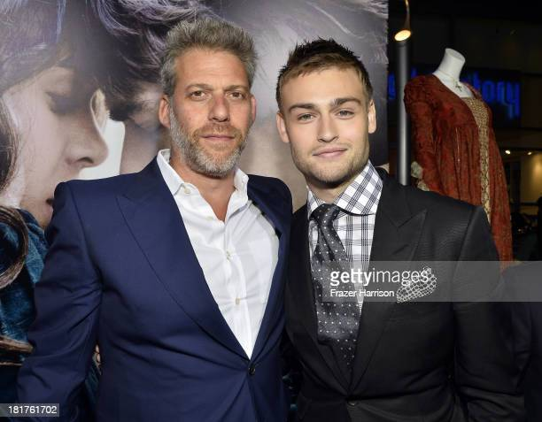 Producer Lawrence Elman and actor Douglas Booth arrive at the premiere of Relativity Media's Romeo And Juliet at ArcLight Cinemas on September 24...