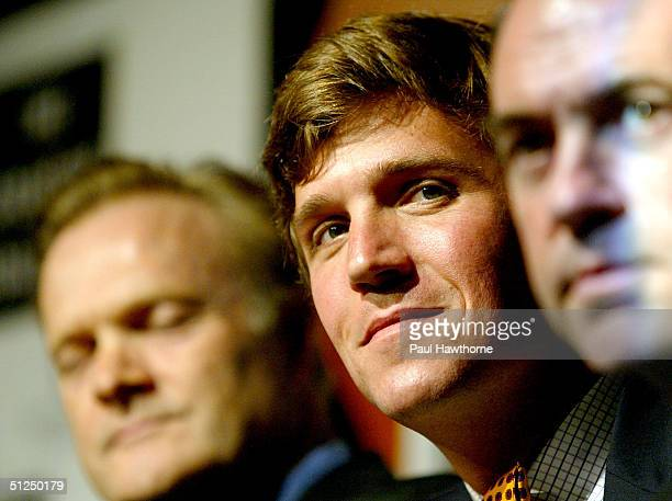 Producer Lawrence O'Donnell, moderator Tucker Carlson and Governor Mike Huckabee of Arkansas take part in an Art$, Education and the 21st Century...