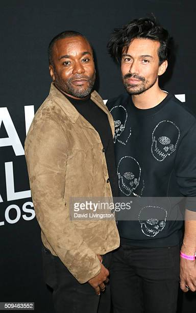 Producer Lee Daniels and Jahil Fisher attend Saint Laurent at Hollywood Palladium on February 10 2016 in Los Angeles California