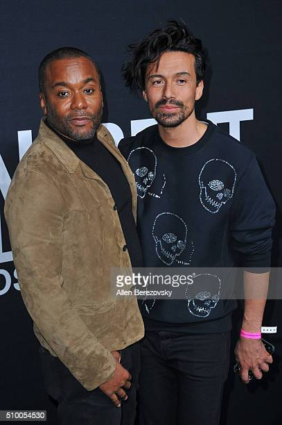 Producer Lee Daniels and Jahil Fisher attend SAINT LAURENT At The Palladium at Hollywood Palladium on February 10 2016 in Los Angeles California