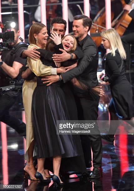 Producer Lena Schömann receives her award from the actors Elyas M'Barek Jessica Schwarz Florian David Fitz and Karoline Herfurth during the...
