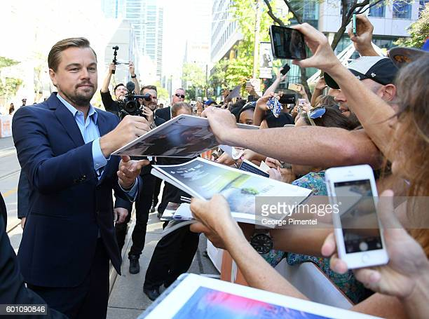 Producer Leonardo DiCaprio signs autographs during the Before the Flood premiere during the 2016 Toronto International Film Festival at Princess of...
