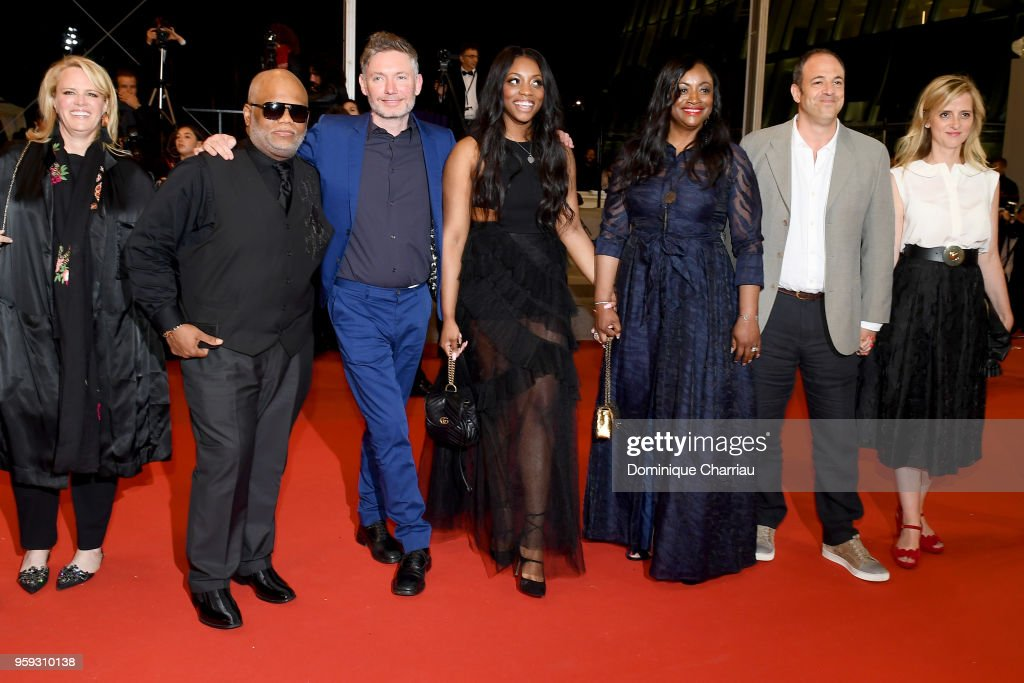 Producer Lisa Erspamer, Ulysses Carter, director Kevin McDonald, Rayah Houston, producer Pat Houston, producer Simon Chinn and Lisa Chinn attend the screening of 'Whitney' during the 71st annual Cannes Film Festival at Palais des Festivals on May 16, 2018 in Cannes, France.