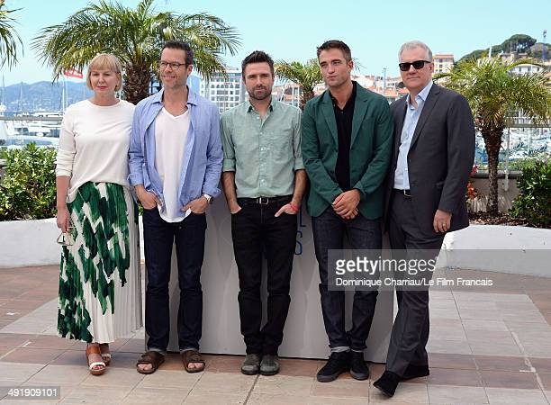 Producer Liz Watts Guy Pearce director David Michod Robert Pattinson and David Linde attend 'The Rover' photocall at the 67th Annual Cannes Film...