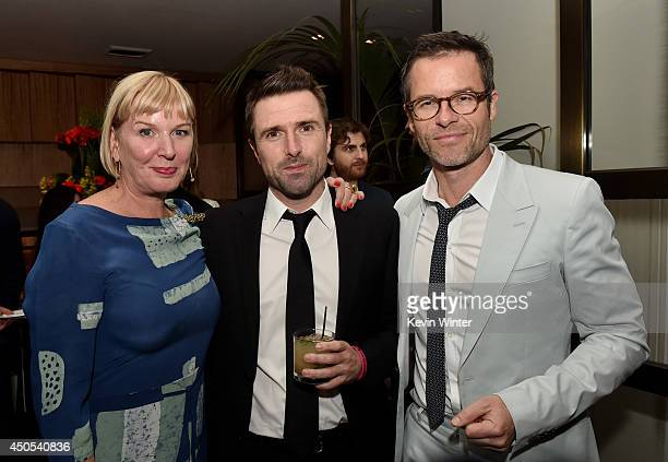 """Producer Liz Watts, writer/director David Michod and actor Guy Pearce pose at the after party for the premiere of A24's """"The Rover"""" at The W Hotel on..."""
