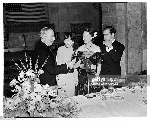 Producer Louis B Mayer presents the Oscar to actress Luise Rainer for the Academy Award for Best Actress and Mrs Louise Tracy accepting for husband...