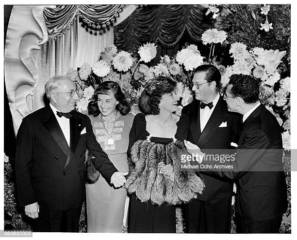 Producer Louis B Mayer with actress Paulette Goddard actress Joan Crawford producer Hunt Stromberg and director George Cukor pose during the premire...
