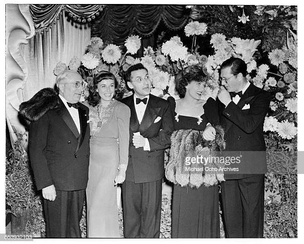 Producer Louis B Mayer with actress Paulette Goddard director George Cukor actress Joan Crawford producer Hunt Stromberg pose during the premire of...