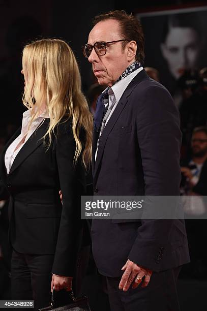 Producer Louise Stratten and director Peter Bogdanovich wearing a JaegerLeCoultre watch attend the 'She's Funny That Way' during the 71st Venice Film...