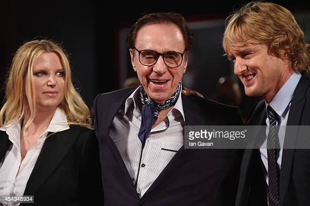 Producer Louise Stratten director Peter Bogdanovich wearing a JaegerLeCoultre watch and actor Owen Wilson attend the 'She's Funny That Way' during...