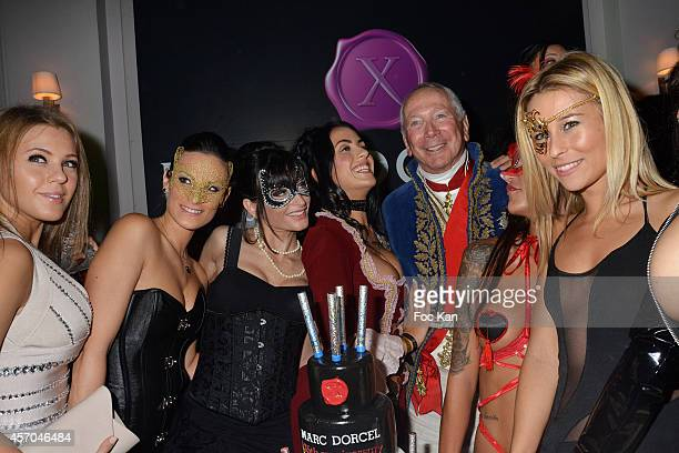 Producer Marc Dorcel poses with X actresses during the Marc Dorcel 35th Anniversary Masked Ball at the Chalet des Iles on October 10 2014 in Paris...