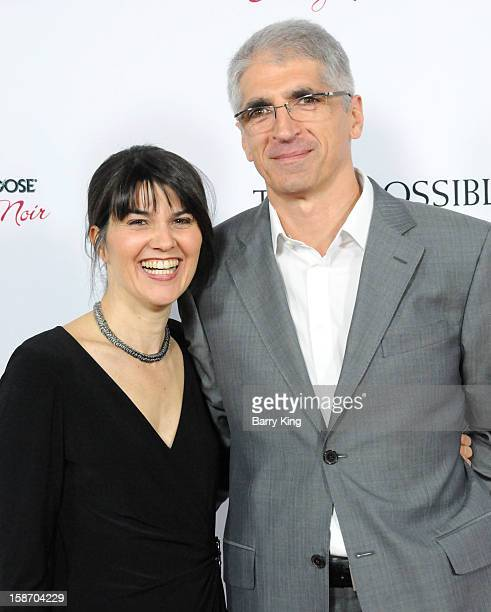 Producer Maria Belon and Enrique Belon arrive at the Los Angeles premiere of 'The Impossible' held at ArcLight Cinemas Cinerama Dome on December 10...
