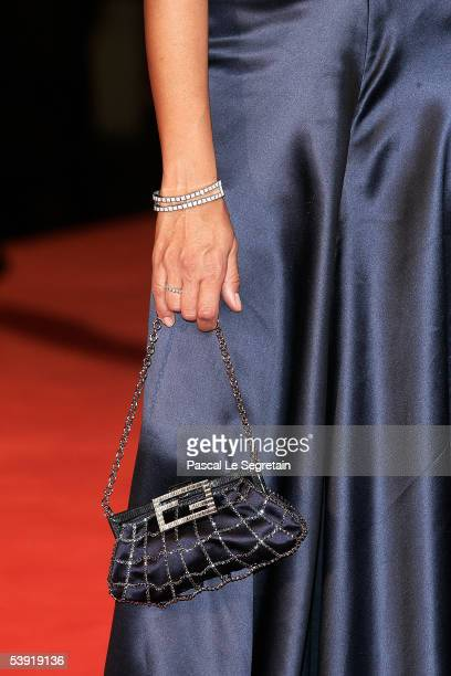 Producer Maria Grazia Cucinotta's bag and watch are seen as she arrives at the premiere for All The Invisible Children at the Palazzo del Cinema as...