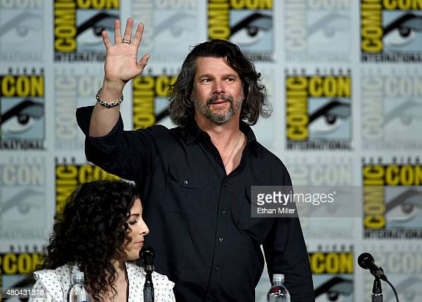 """Producer Maril Davis and writer/producer Ronald D. Moore attend the Starz: """"Outlander"""" panel during Comic-Con International 2015 at the San Diego..."""