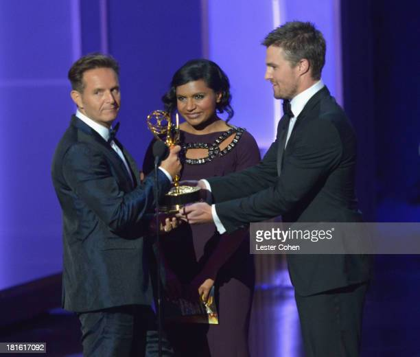 Producer Mark Burnett actress Mindy Kaling and actor Stephen Amell speak onstage during the 65th Annual Primetime Emmy Awards held at Nokia Theatre...