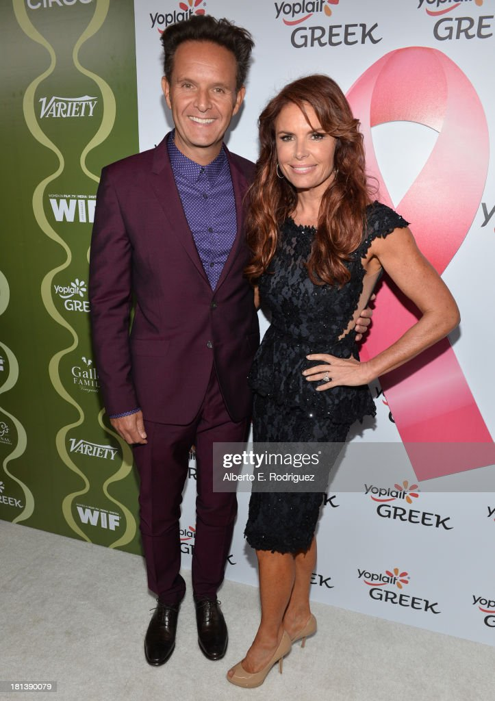 Producer Mark Burnett and actress Roma Downey attend Variety & Women In Film Pre-Emmy Event presented by Yoplait Greek at Scarpetta on September 20, 2013 in Beverly Hills, California.