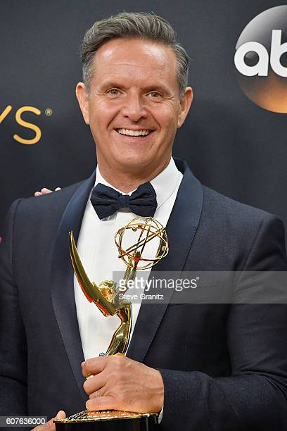 Producer Mark Burnett winner of the award for Outstanding RealityCompetition Series for 'The Voice' poses in the press room during the 68th Annual...