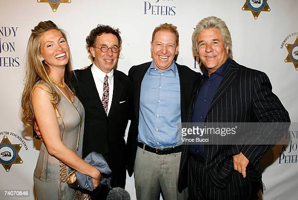 Producer Mark Canton and Ryan Kavanaugh CEO Relativity Media pose with producers Mindy Peters and Jon Peters at the Los Angeles County Sheriff's...