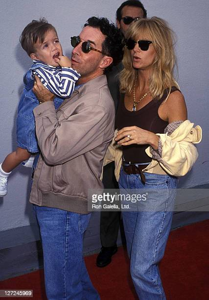 Producer Mark Canton and son and actress Goldie Hawn attend the 'Aladdin' Hollywood Premiere on November 8 1992 at the El Capitan Theatre in...