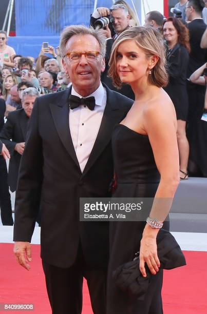 Producer Mark Johnson and a guest attend the Opening Night Screening and World Premiere of 'Downsizing' during the 74th Venice Film Festival at...